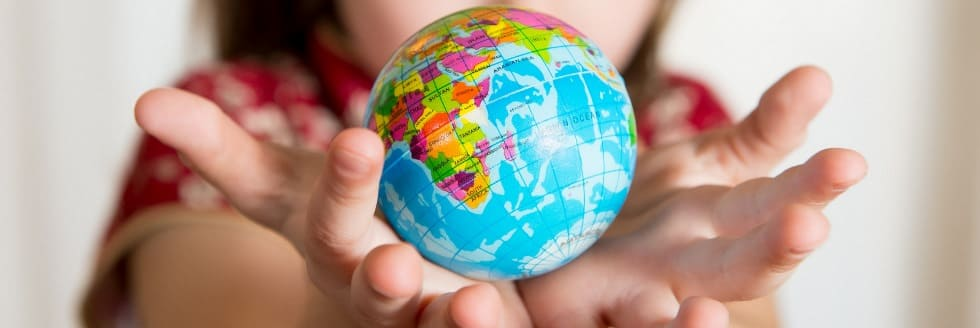 Cute little girl holding World Globe on her Hands